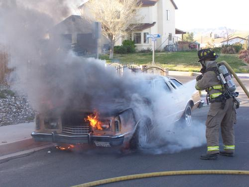 Fire Fighter extinguishes car fire
