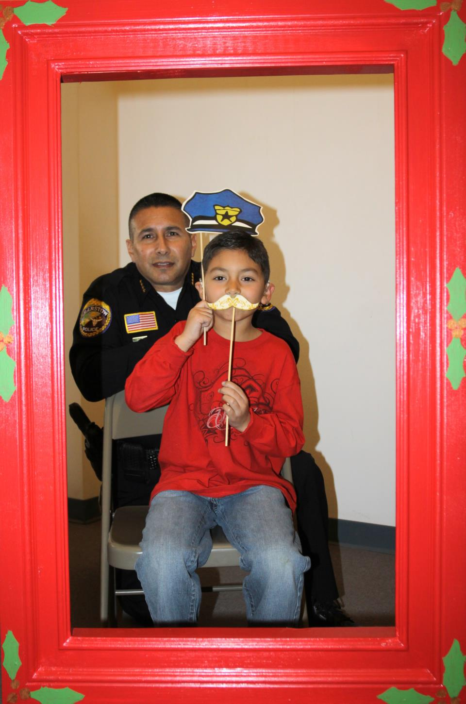 Chief Ramirez and PAL member pose for Christmas Photo