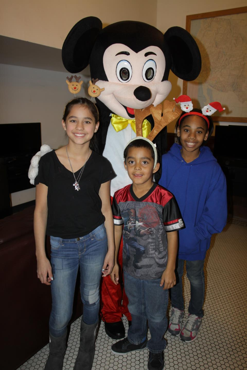 PAL Members pose with Mickey Mouse