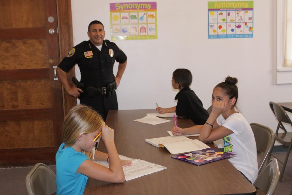 Chief Ramirez and PAL members doing homework